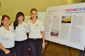 Vardanyan and Honors Scholars peers present research.