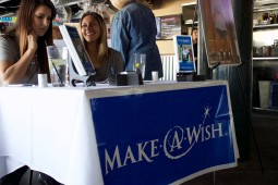 Lechuga (l) and her colleague working the Make-A-Wish booth.