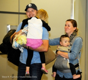 Tim and Amber Kanallakan, of Visalia, travelled to China to adopt Oliver Douglas Qiang Kanallakan, 11 months old, and came home April 26 to a hero's welcome from family and friends at the Fresno-Yosemite International airport. Photo Credit: Steve R. Fujimoto