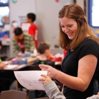 Fresno State Interpreting intern Courtney Dull signs to students at Garfield Elementary.