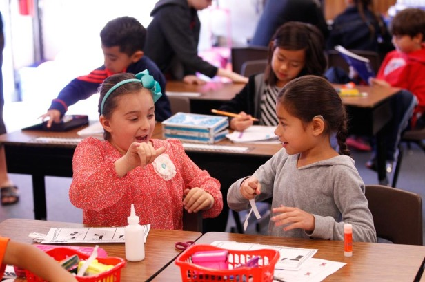 Garfield Elementary first-graders Hailey Baroni (L) and Jazlene Jimenez (R). Photo Credit: Cary Edmondson, Fresno State Magazine