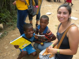 Rios and local children.=, thrilled to receive new school supplies.